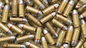 POWW stock many ammunition bullets pattern background
