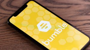 The logo for Bumble (BMBL) is displayed on a smartphone screen.