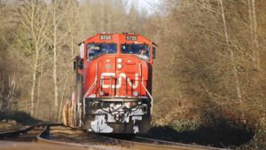 A photo of a Canadian National (CNI) train coming down the tracks toward the photographer.