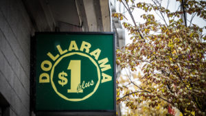 Dollarama logo in front of their local shop in downtown Montreal, Quebec.