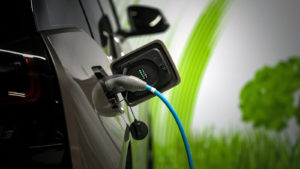 Depth of field shot of an electric vehicle being charged.