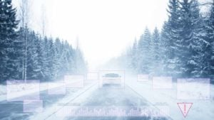 A graphic showing a car driving down a snowy road with its lidar scanning the surroundings.