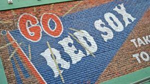 "A painting says ""Go Red Sox"" at Fenway Park."