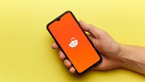 reddit social network logo on mobile phone screen.