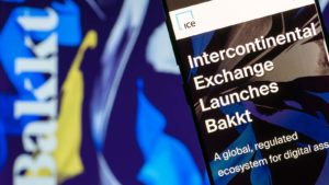 "A close-up shot of a phone screen that reads ""Intercontinental Exchange Launches Bakkt"""