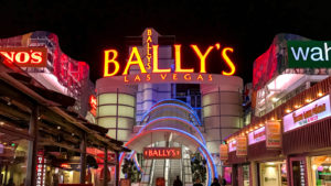 BALY stock Entrance to Bally's Hotel on the Las Vegas Strip lit up at night.