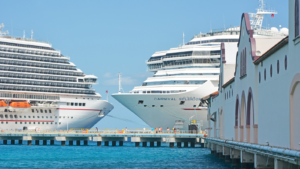 CCL stock cruise stocks docked cruise ships
