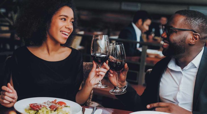 A photo of a couple on a date in a restaurant.