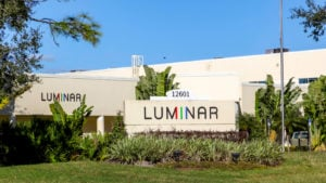 Luminar (LAZR) sign with greenery around it