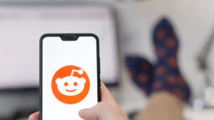 Reddit logo on smartphone screen