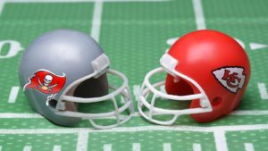 Concept art showing the helmets for the Kansas City Chiefs and the Tampa Bay Buccaneers.