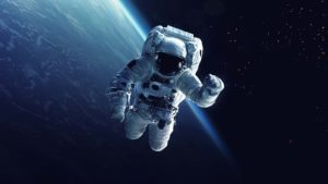 A concept art of an astronaut with a space secene behind.