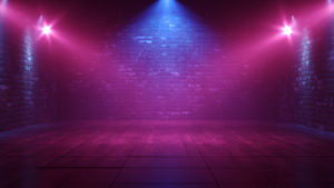 an empty stage at a night club with blue and purple lights