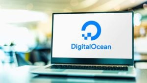A laptop screen displays the logo for DigitalOcean (DOCN).
