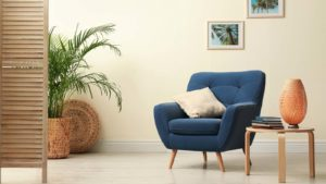 A staged room with a blue chair in focus.