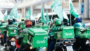 A group of Grab riders on motorbikes in Bangkok, Thailand.