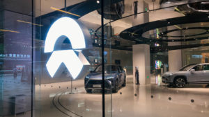 Image showing a Nio store with a glowing logo on the front.