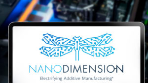 Nano Dimension logo in an iPad, on the background their proprietary 3D printer