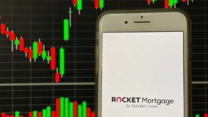 The logo for Rocket Companies displayed on a smartphone screen (RKT).