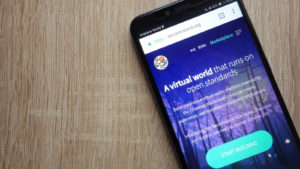 Smartphone open to Decentraland's home page