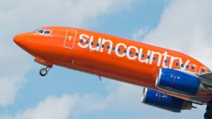 A Sun Country Airlines plane taking off.