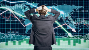 stocks that could crash; Businessman grabs the head concept with business chart on scoreboard