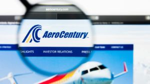 A magnifying glass zooms in on the website for AeroCentury (ACY).