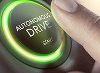 """A finger hovering over an """"autonomous drive"""" button"""