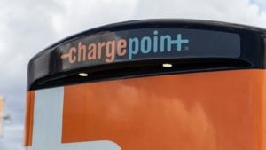 A close-up of an orange ChargePoint (CHPT) station.