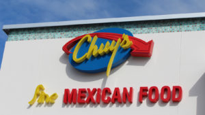 A photo of Chuy's (CHUY) sign on the outside or a restaurant.