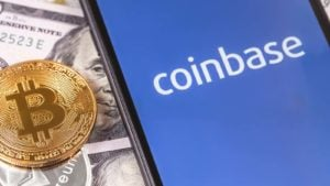 The Coinbase (COIN) logo on a smartphone screen with a BTC token.
