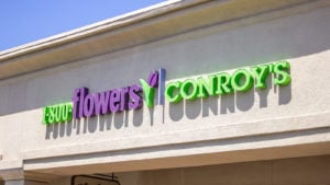 A store front sign for the florist shop known as Conroy's or 1-800-Flowers