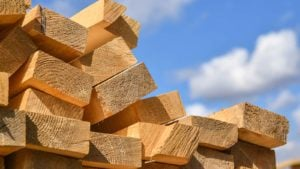 A stack of lumber with a blue sky in the background.