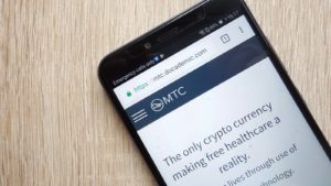 The website for Doc.com (MTC) displayed on a smartphone.