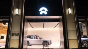 A shot from the outside of a Nio (NIO) display room at night.