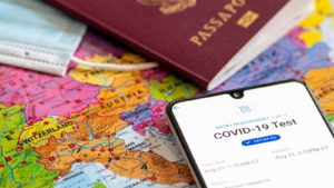 A concept image of a Covid-19 vaccine passport and a real passport on a map of Europe.