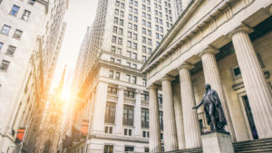 Image of Wall Street with the Washington Statue present representing pre-market stock movers.