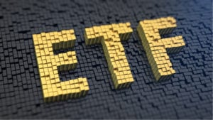 """the word """"etf"""" spelled out in many yellow cubes against a background of many black cubes"""