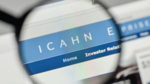 A magnifying glass zooms in on the website for Icahn Enterprises (IEP).