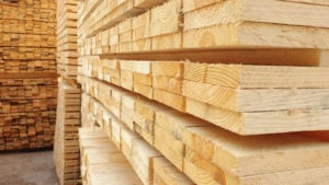 Piles of 2x4s in a warehouse
