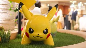 A Pikachu statue in grass.