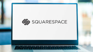 """Image of a computer with """"Squarespace"""" on it"""