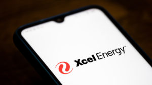 close-up of Xcel Energy (XCEL) logo in black and red displayed on smartphone screen