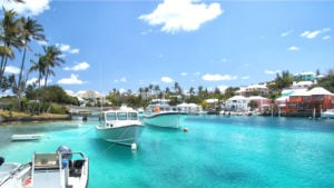Several yachts are harbored near a waterfront resort in Hamilton, Bermuda.