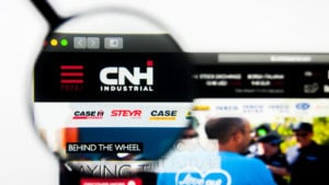A magnifying glass is focused on the logo for CNH Industrial on the company's website.