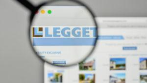 A magnifying glass is focused on the logo for Leggett & Platt on the company's website.