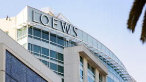 The word Loews is seen at the top of Loews Hollywood Hotel.