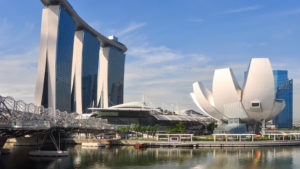The Marina Bay Sands hotel and the ArtScience Museum are visible behind a waterfront in the city center of Singapore.
