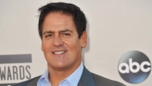 A close-up shot of Mark Cuban in front of a red carpet background.