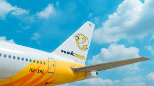 A close-up of the tail of a Nok Airlines plane.